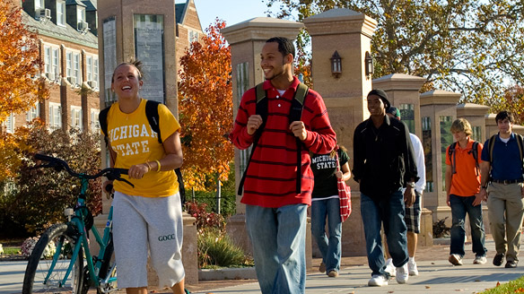 Students walk on campus in the fall