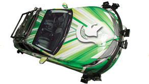 Artist's conception of an autonomous car in shades of green with the Spartan helmet logo on the hood