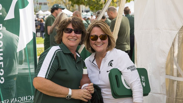 Two Broad alumni enjoy themselves at a college tailgate