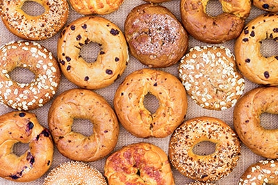 A stock photo overhead shot of assorted bagels.