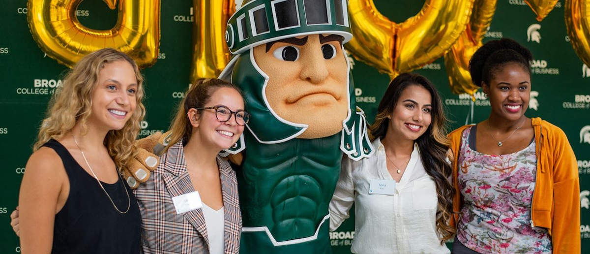 A group of Broad College students pose with Sparty, MSU's mascot, at a college event.