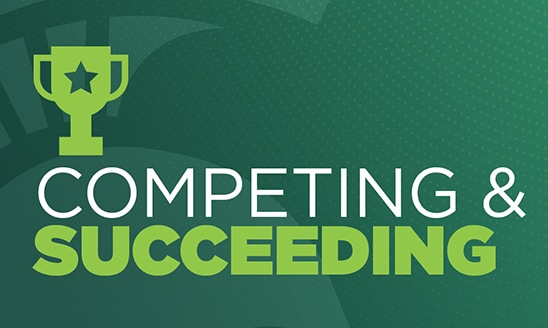 A green graphic with a Spartan helmet and a trophy and text that reads: Competing and Succeeding.