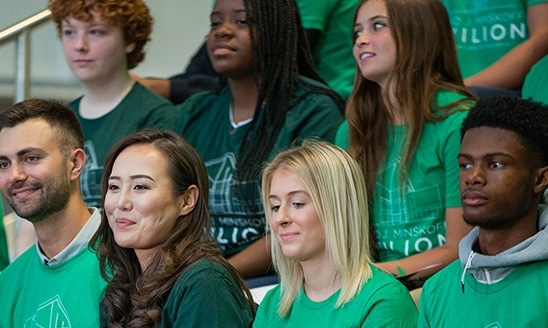 A diverse group of Broad College students dressed in green for the Minskoff Pavilion ribbon-cutting ceremony September 2019.
