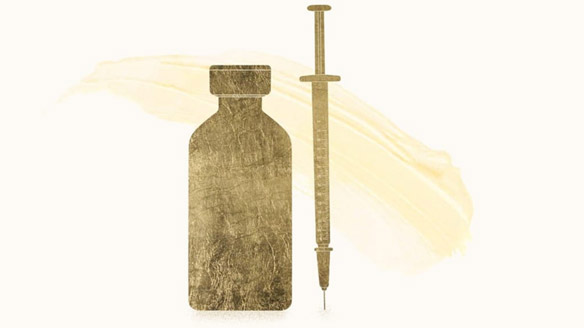 A gold medicine bottle and syringe in front of a gold paint stroke