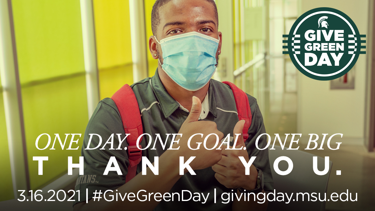 A man wearing a face mask giving thumbs-up for Give Green Day on March 16, 2021, with text