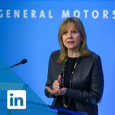 Mary Barra speaks in front of a backdrop reading General Motors