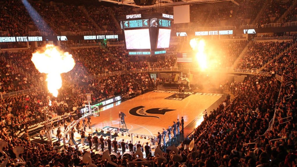 Pyrotechnic effects go off during Michigan State Madness at a packed Breslin Center