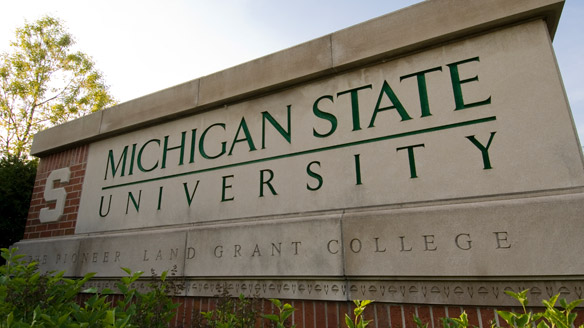 Sign at the Shaw Lane entrance to campus: Michigan State University - the pioneer land grant college