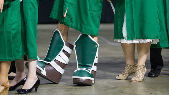 Feet at commencement, including one set in Sparty boots