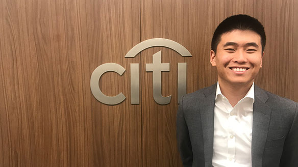 Parker Decraene poses by Citi logo wall sign