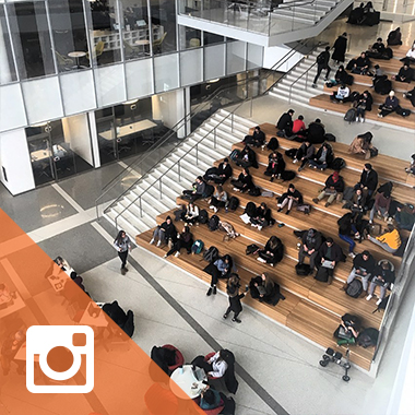 A bird's eye view of the Minskoff Pavilion atrium filled with students.