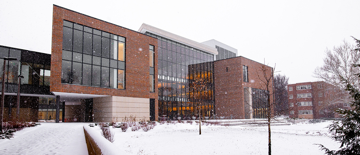 A view of the Minskoff Pavilion's rear (North) side as snow falls on campus.