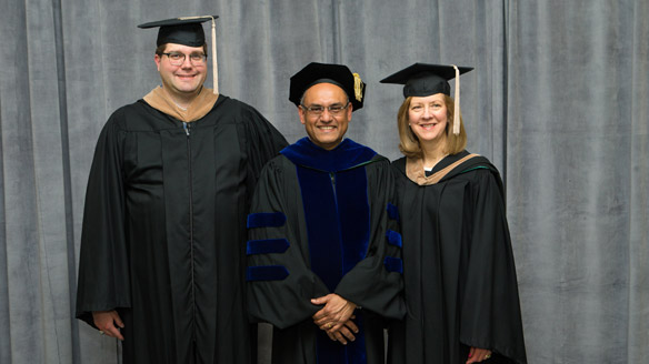 Mike Pruente, Dean Sanjay Gupta, and Nancy Vella in their graduation regalia