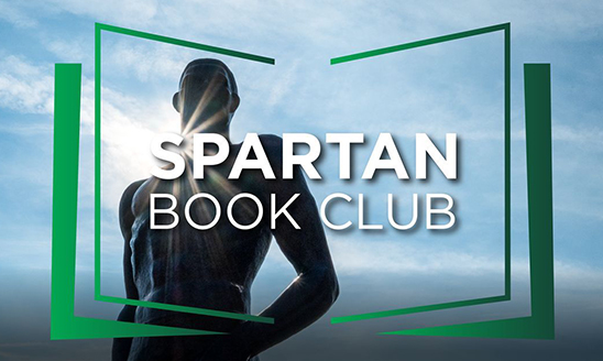 White text reads: Spartan Book Club surrounded by a green graphic symbolizing a book, overlaid on an image of MSU's Sparty statue on campus on a sunny day.