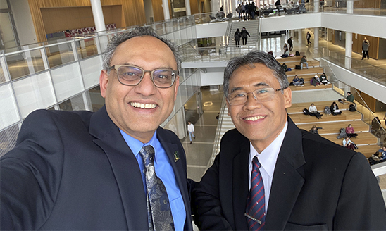 Dean Sanjay Gupta shows UGM Rector/President Panut Mulyono around the Minskoff Pavilion.