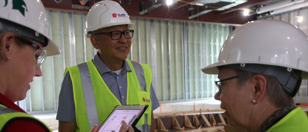 Frank Yang, center, president of INCODEL Michigan LLC of Romulus, Mich., and Lucy Maillette, right, the college's director of new academic initiatives and former EMBA director, take a hard hat tour of the Broad College Business Pavilion work site recently.
