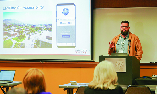 A man speaking to a classroom of conference attendees at MSU's Accessible Learning Conference.