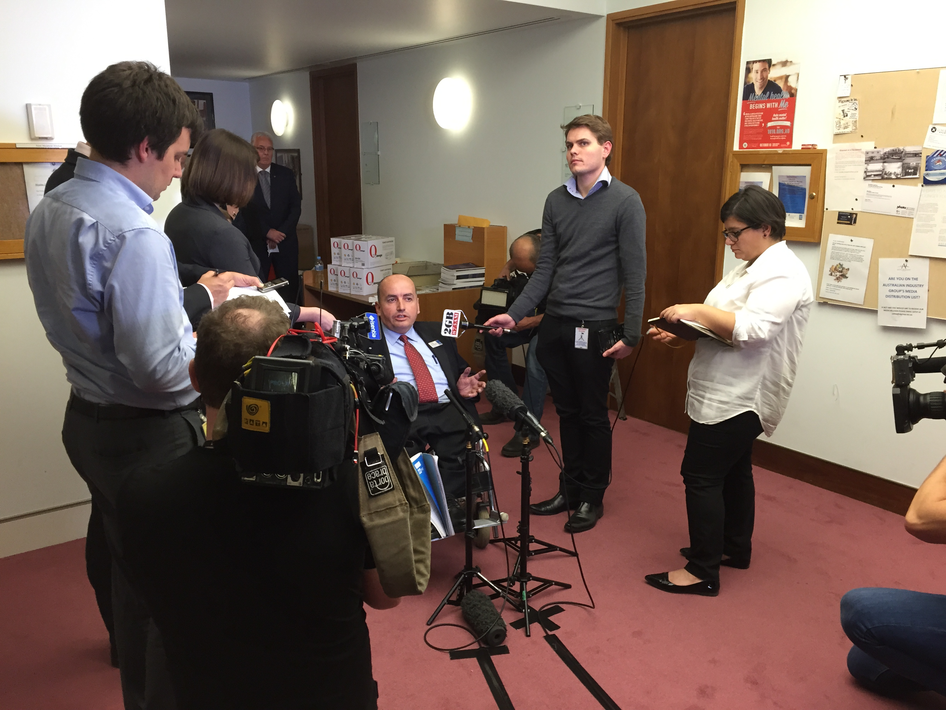 IMAGE: People with Disability Australia President Craig Wallace answering questions from TV, newspaper and radio journalists about the 2015 Federal Budget