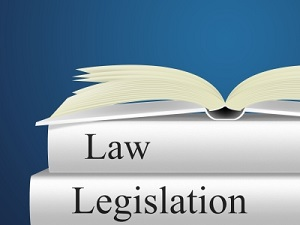 IMAGE: An open book sits on top of two other books titled Law and Legislation.Image courtesy of Stuart Miles at FreeDigitalPhotos.net