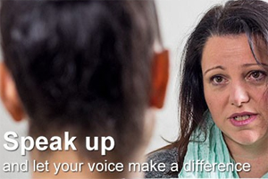 IMAGE: White text spells out Speak up and let your voice make a difference over an image of two people talking