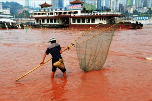 The Yangtze river, September 6, 2012, in Chongqing, China. The Yangtze is usually brown to orange because of silt runoff from deforestation, but the new red color leads to suspicion that serious industrial pollutants are entering the river.