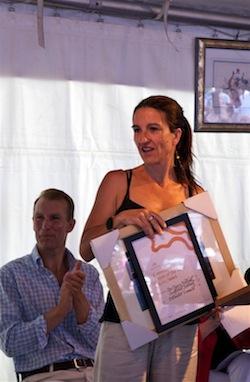 Emmie receiving award